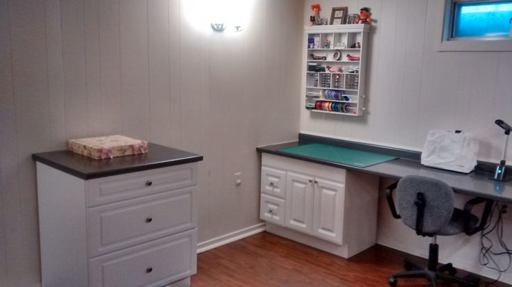 """Embellishment corner again with my paper storage """"Island"""" in the corner.  This is on wheels so I can move it wherever I want.  The surface on top is also the same countertop used throughout the room."""