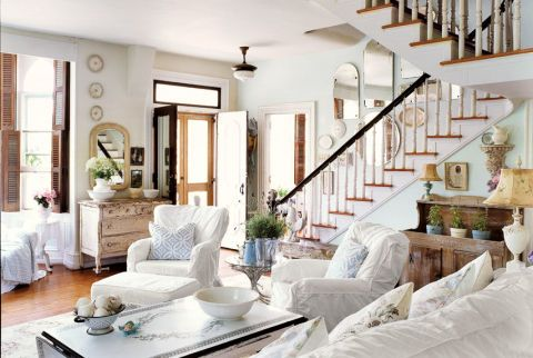 The all-white living room of this San Francisco home perfects the crumpled, imperfect look and creates a cozy atmosphere. White is paired with pastels and mellow shades that impart just a whisper of smoky pink, blue, or green.