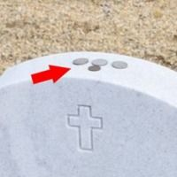 If You See A Coin On A Headstone, Do Not Touch It Or Pick It Up - Here's Why