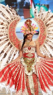 Miss Indonesia Maria Selena shows off the national costume for Indonesia
