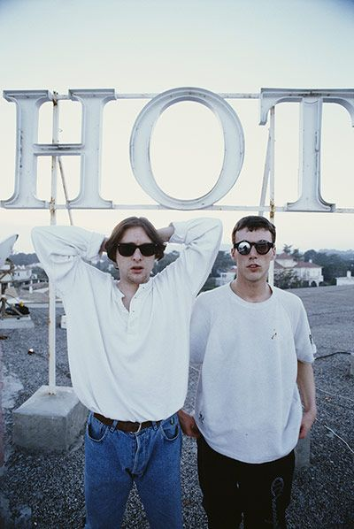 Shaun Ryder and Bez of the Happy Mondays on the roof of the Hotel Subur Maritim, Sitges, Spain, March 1990 Photograph: Kevin Cummins/Getty Images