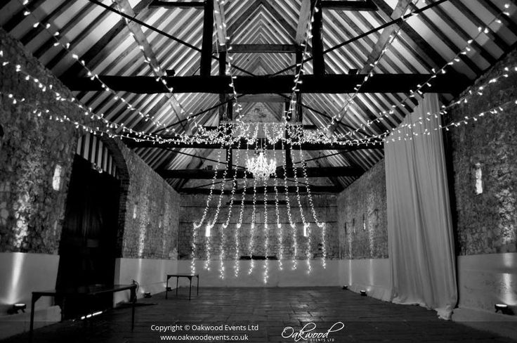 Gathered fairy light canopy with central white chandelier #monksbarn #chandelier #fairylights
