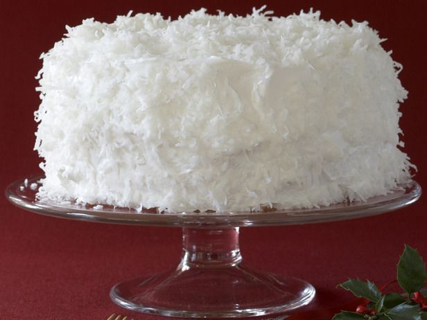 Paula's Coconut Cake - A flurry of flaked coconut coats this snow-white layer cake, deliciously bringing the winter wonderland indoors.