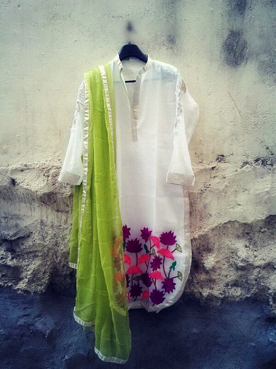 Very summery  vibrant and colorful white kurti with by Sravams, $110.00