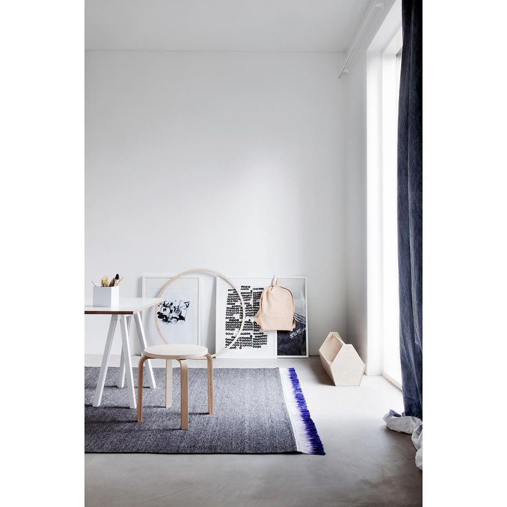 Dress the floor. The FLUX rug's vivid blue fringe against the concrete floor is a winning contrast. The sharp colour of the fringe is created using an ancient dip dye technique.