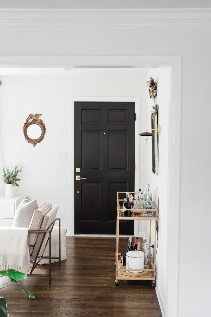 Painting interior doors black is an easy way to add graphic elegance to your space. | A Bright Nashville Home for a Stylist and Musician | Design*Sponge
