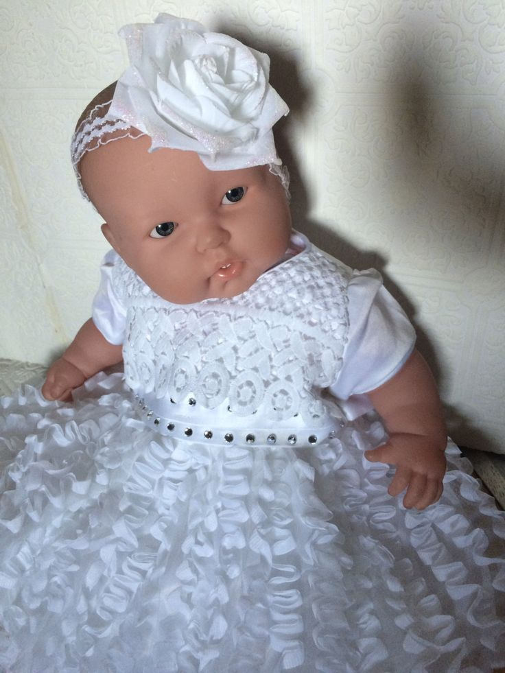 A beautiful baptism dress for your little darling! Made out of white polyester, acrylic and cotton fabric, with gem studs. Comes with a beautiful rose clip or headband.    Hand wash only- do not dry in dryer.  The bottom of the dress is delicate and would lose its shape if placed in dryer.   Size: