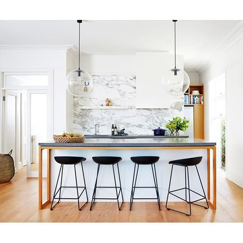 Check out this contemporary kitchen renovation. By knocking down walls the kitchen became part of the living spaces and the centre of family life.