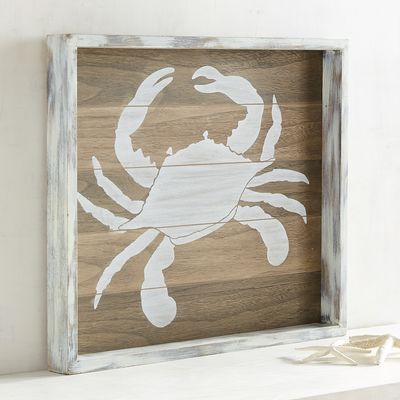 "Did you know that a group of crabs is called a ""cast""? With its distressed wooden planks and hand-painted finish, our crustacean-centered wall decor is destined to be part of a whimsical production in your home."