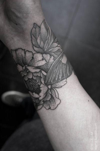 flower wrist cuff tattoo. i'd get it on my upper arm