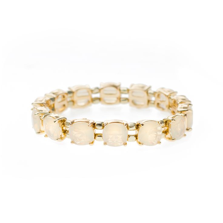 This elegant, gold-tone crystal accessory is ideal for injecting subtle color into neutral ensembles. This stunning design looks great as a solo piece or stacked together with similar designs.