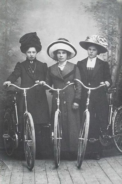 Three ladies with bikes, 1912