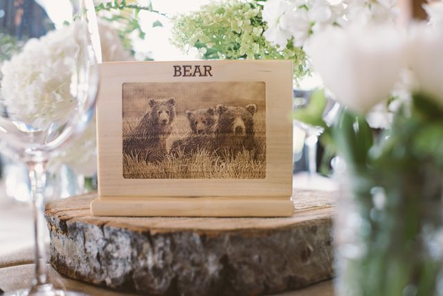 Engraved wood wildlife table numbers | Canmore Mountain Wedding | naturallychic.ca | Photo by Abby + Dave Photography.