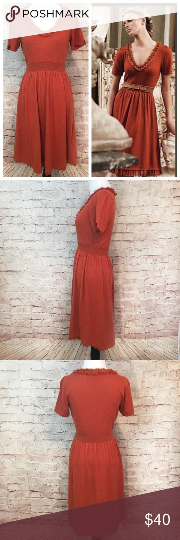 """Isabella Sinclair Anthropologie Dress Isabella Sinclair pullover burnt orange a-line dress with short sleeves, elastic smocking waist band and chiffon ruffle around the v-neckline and hem from Anthropologie.  Viscose/Nylon/Cotton/Extra fine Wool/Angora.  Size Small. Measurements laying flat: Bust 16.5"""". Length 36"""". Like new condition. No flaws or signs of wear.  (Belt added in the stock photo not included). Anthropologie Dresses"""