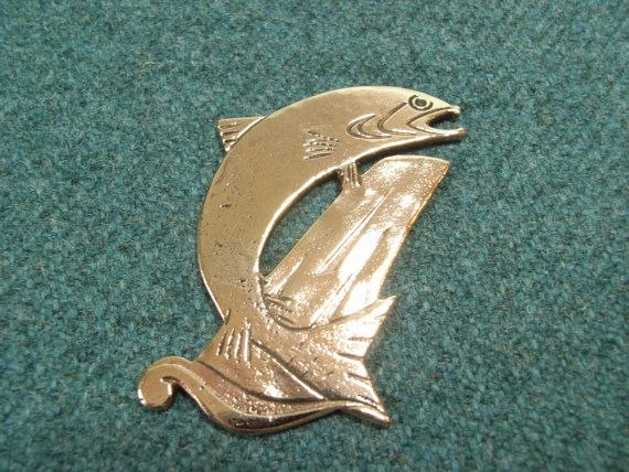 Check out this item in my Etsy shop https://www.etsy.com/uk/listing/255847255/scottish-salmon-kilt-pin-in-bronze-free