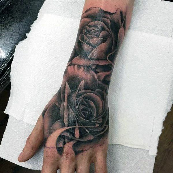 130 Best Hand Tattoos That Don T Go Out Of Style Hand Tattoos For Guys Rose Tattoos For Men Men Flower Tattoo