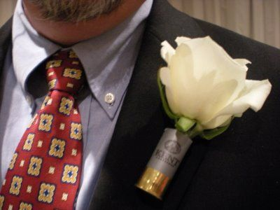 Probably the cutest thing ever!!! What better way to talk your guy into wear a boutonniere... shot gun shells!!