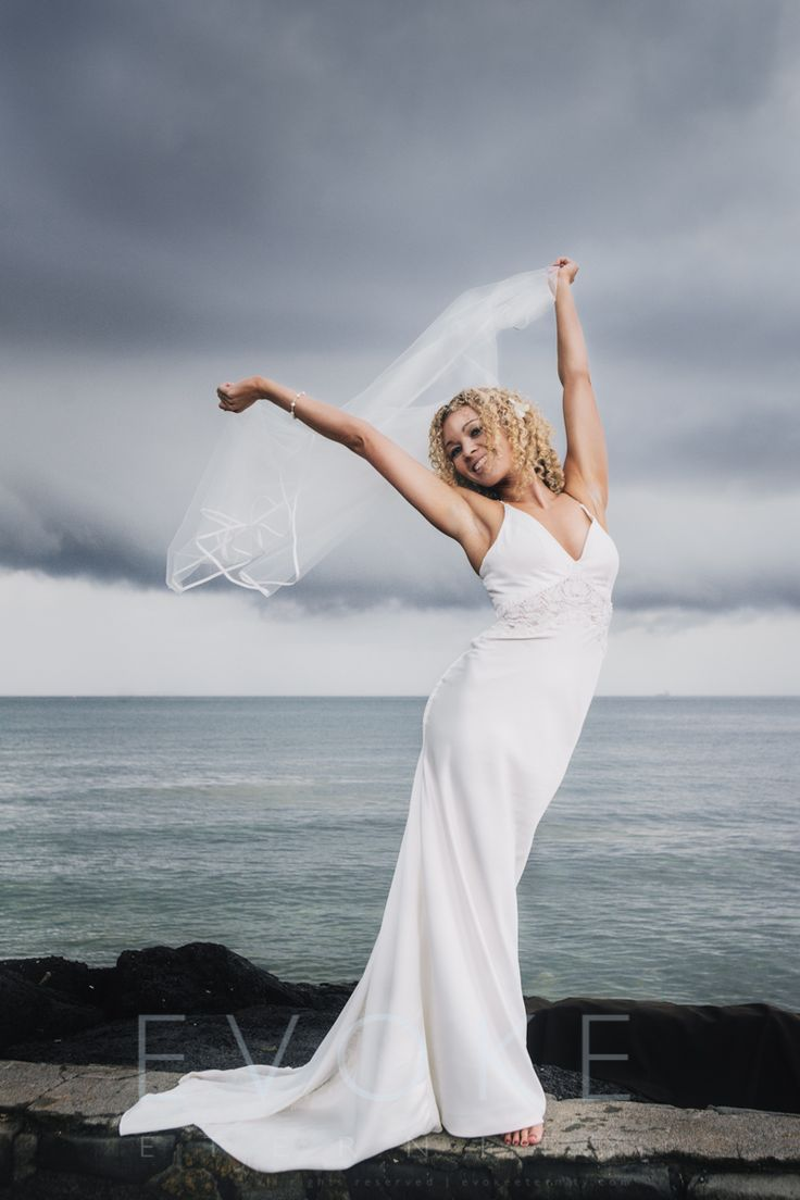 Happy to oblige a bride who just wanted to dance in the wind.  This was captured on the beach, in between the rain and with another storm coming very shortly after.  The bride didn't mind as she was over the moon she was marrying her life partner that day!  Photography by Wayne Wong with Evoke Eternity (http://www.evokeeternity.com).    See more of Evoke Eternity's Wedding photography services in Australia at http://www.evokeeternity.com/wedding-photography/