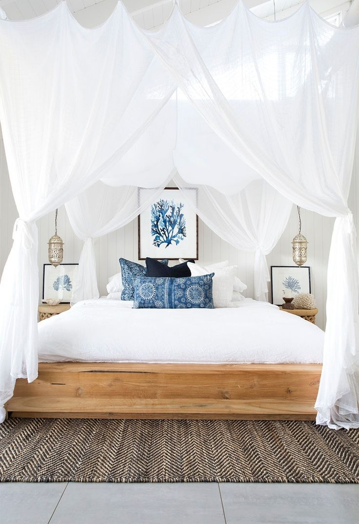 Use flowing linens, blue accents, + seashell acces…