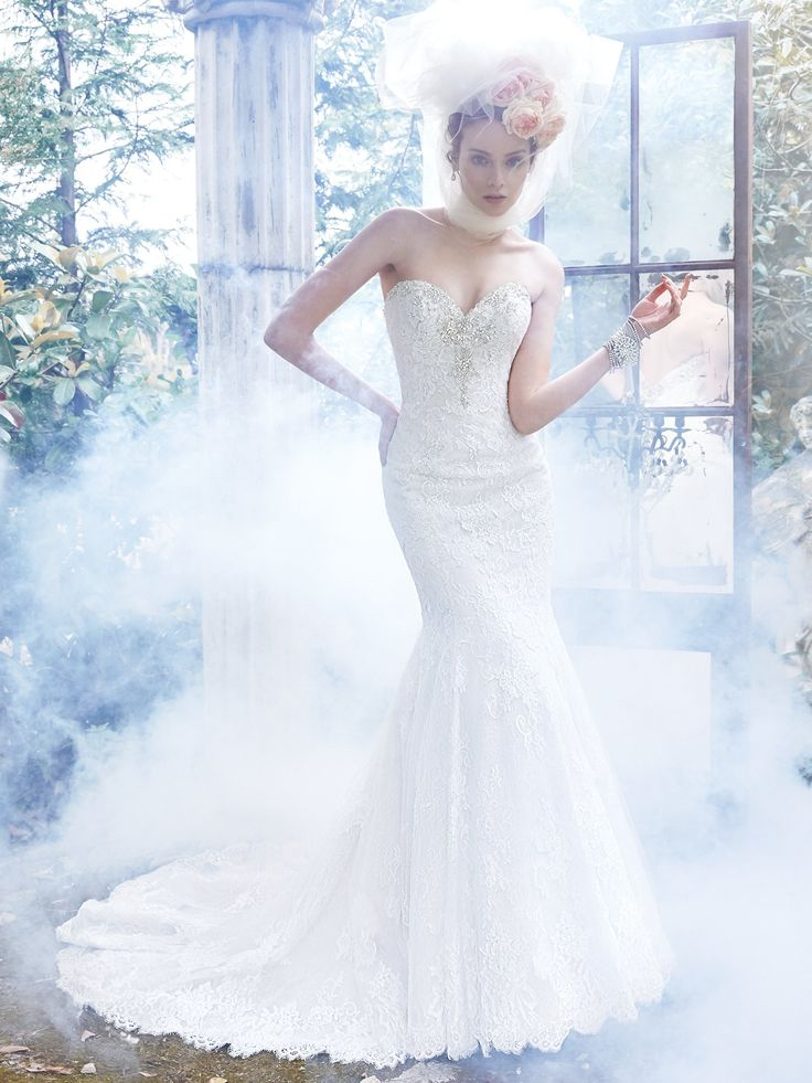 Lovely Maggie Sottero Amarosa Glamorous Swarovski crystals adorn the romantic sweetheart neckline of this classic fit