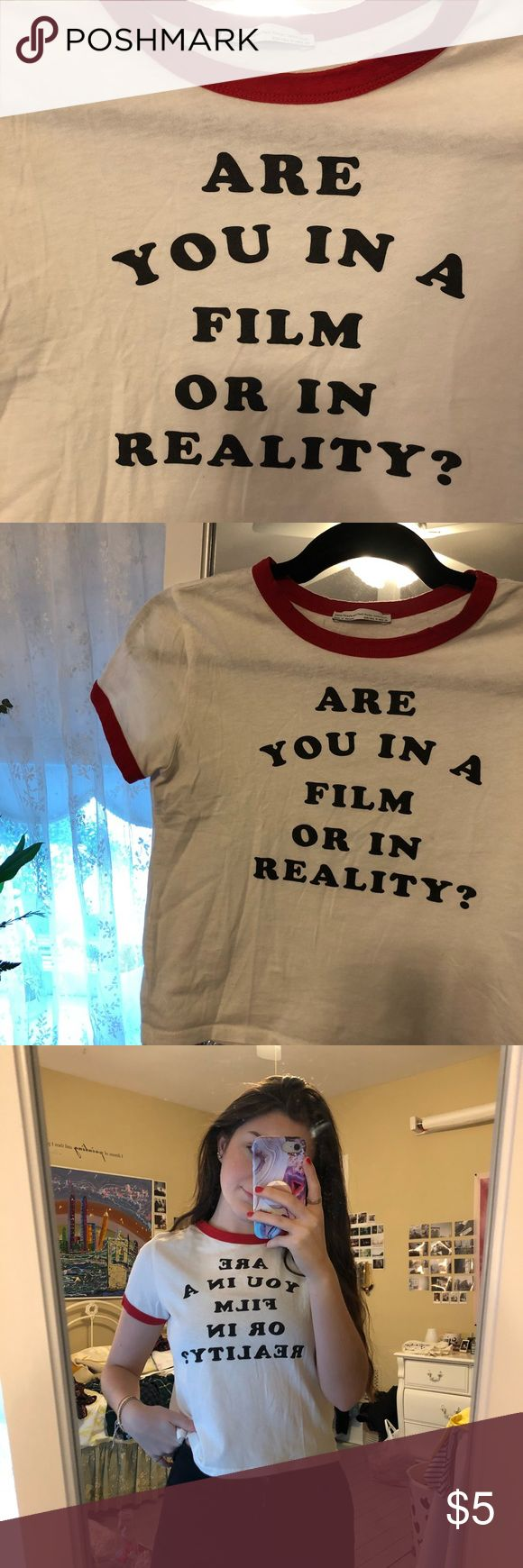 "Zara Tshirt ""ARE YOU IN A FILM OR IN REALITY"" tshirt from zara. Red outline detail with black lettering. Only worn once. Labeled as US medium but fits like a small. Zara Tops Tees - Short Sleeve"