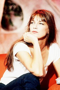 In 1981, Hermès chief executive Jean-Louis Dumas was seated next to Jane Birkin on a flight from Paris to London. She had just placed her straw bag in the overhead compartment of her seat, but the contents fell to the floor, leaving her to scramble to replace the contents. Birkin explained to Dumas that it had been difficult to find a leather weekend bag she liked. In 1984, he created a black supple leather bag for her: the Birkin bag