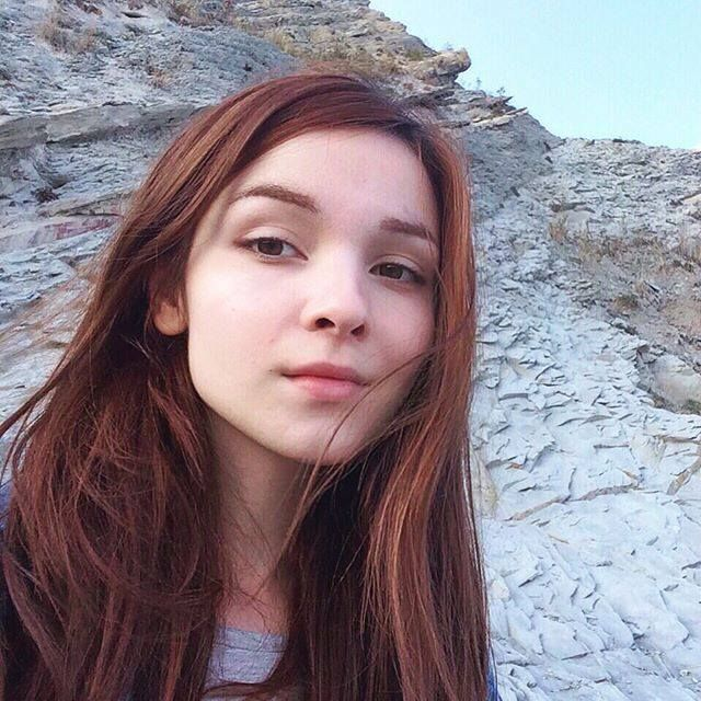 Katya Lischina with brown hair