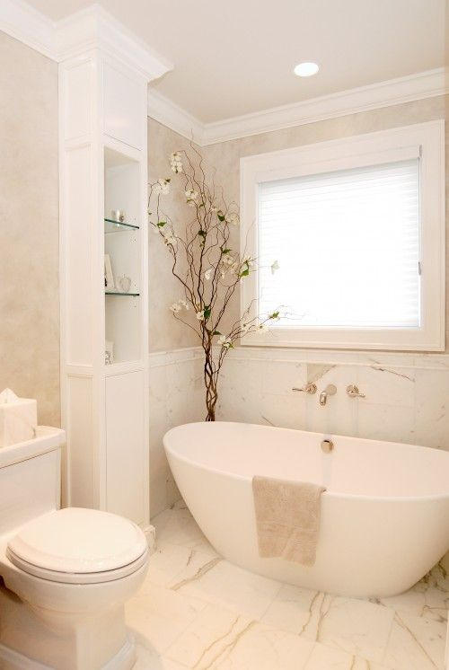 Love the tub and the tree in the corner :) Another beautiful white bathroom!