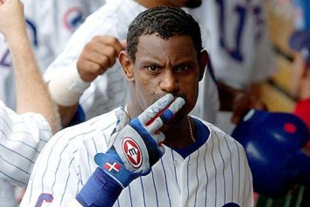 sammy sosa blows kisses to the wgn dugout camera after another homerun.