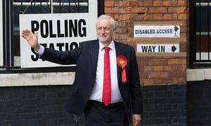 Labour leader Jeremy Corbyn walks to the polling station in London.