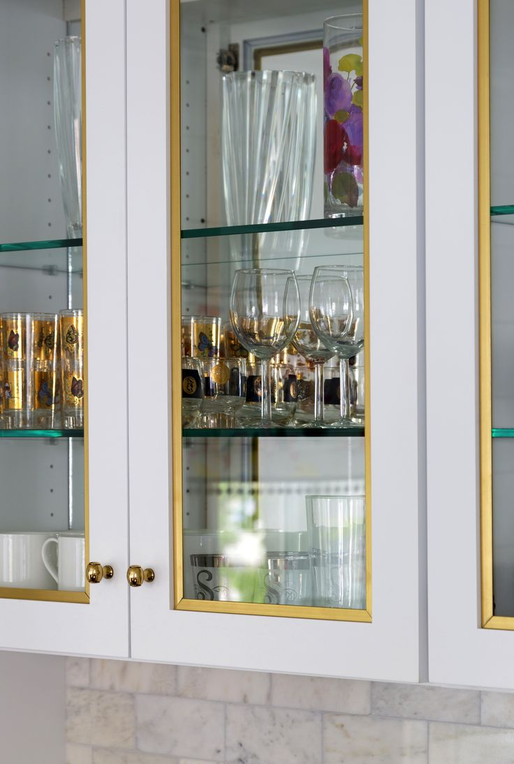 Design Manifest Kitchen - White and Gold China Cabinets with glass doors and mirrored backs