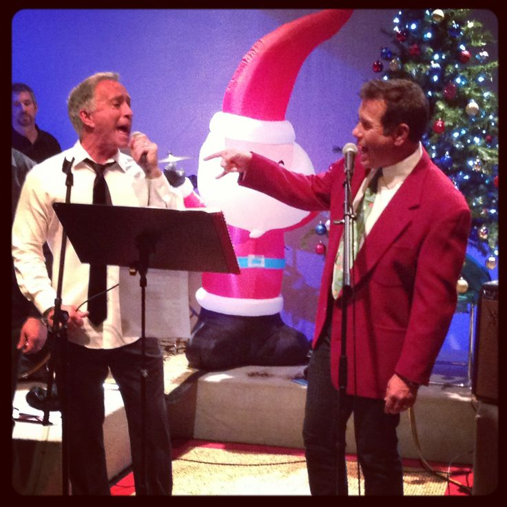 Sports Director Mark Ibanez and Anchor Ken Wayne singing
