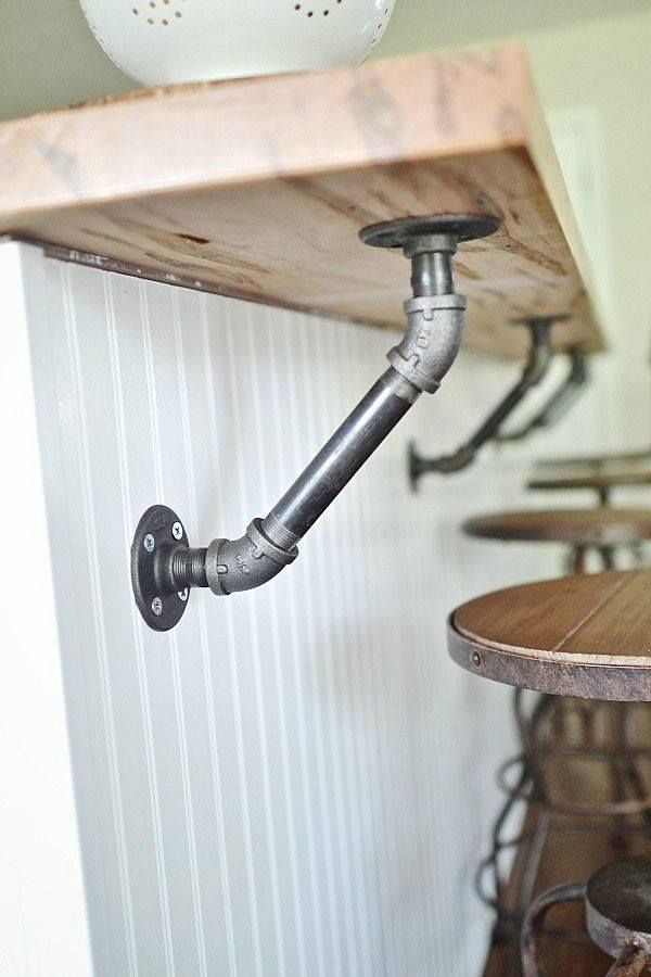 Use industrial pipes to hold up a wood bar!