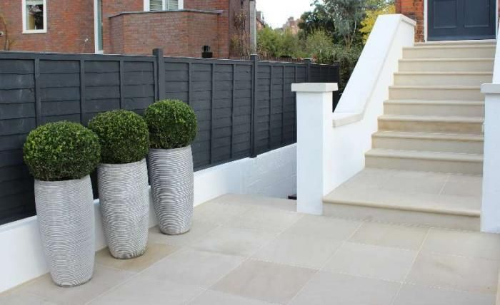Fork Garden Design have used our Beige Sawn Sandstone Paving and matching Step Treads and Coping Stones to create a smart entrance to this home.