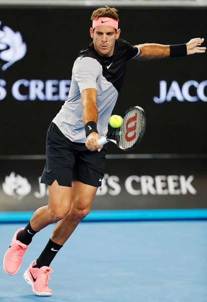 Juan Martin Del Potro Photos - Juan Martin del Potro of Argentina hits a backhand in his first round match against Frances Tiafoe of the US on day two of the 2018 Australian Open at Melbourne Park on January 16, 2018 in Melbourne, Australia. - 2018 Australian Open - Day 2