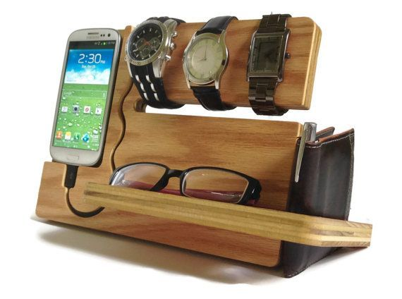 "Super cool accessory caddy; love the design. (There's a cup for keys & coins on the back.) ""Watch and Eye Dock Galaxy S4 S3"" by undulatingcontours on Etsy, $42"