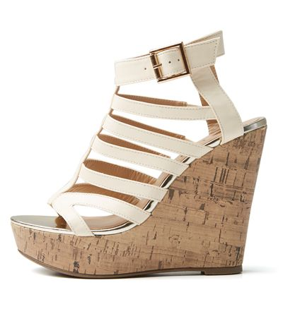 Give your boyfriend denims a feminine twist with these wedges.