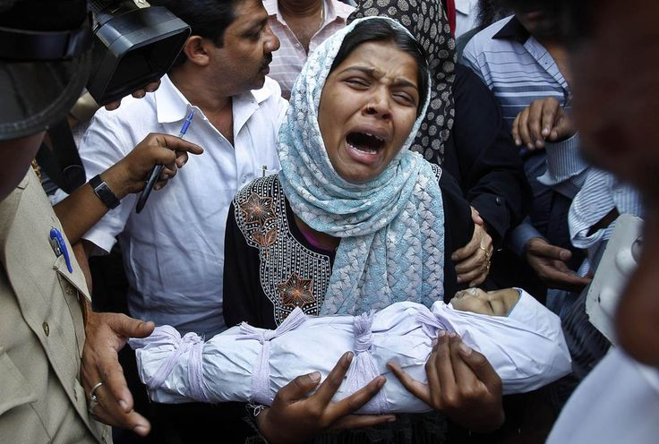 Apparently, in some countries, being female is wrong. -  Wailing mother holds 3 month old daughter who was beaten to death by her own father for being born female. - What will the world be without mothers and daughters.