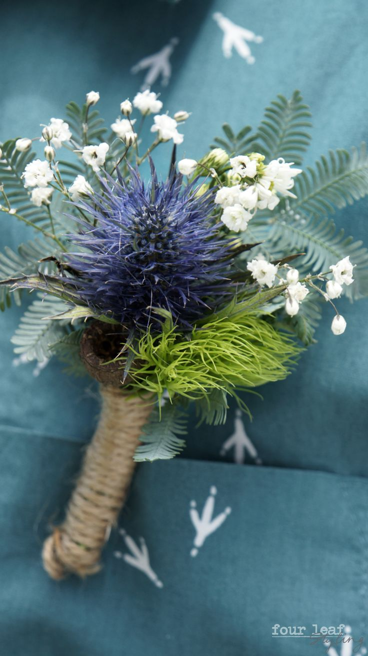 E+T's rustic Wedding, Sea Holly buttonhole by Shannyn Q, Joan O'Reillys Florist