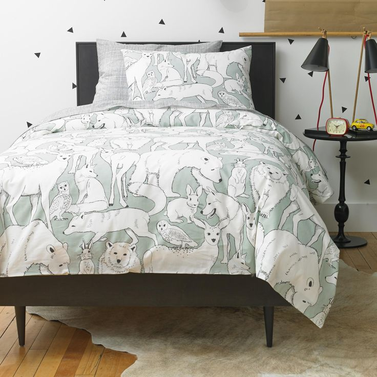 Wildwood Celadon Duvet Set | Meet Wildwood. Inspired by vintage ink drawings, we created a whimsical world with our favorite woodland animals. The vibrant background highlights the artistry of our designers in the unique, illustration style of the black and white drawing.
