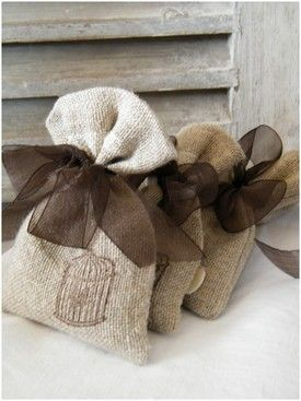 Simple & charming ... burlap bag with brown organza or satin ribbon and a stamp on front - perhaps a stamped image as a 'hint' for what's inside... or perhaps a monogram.