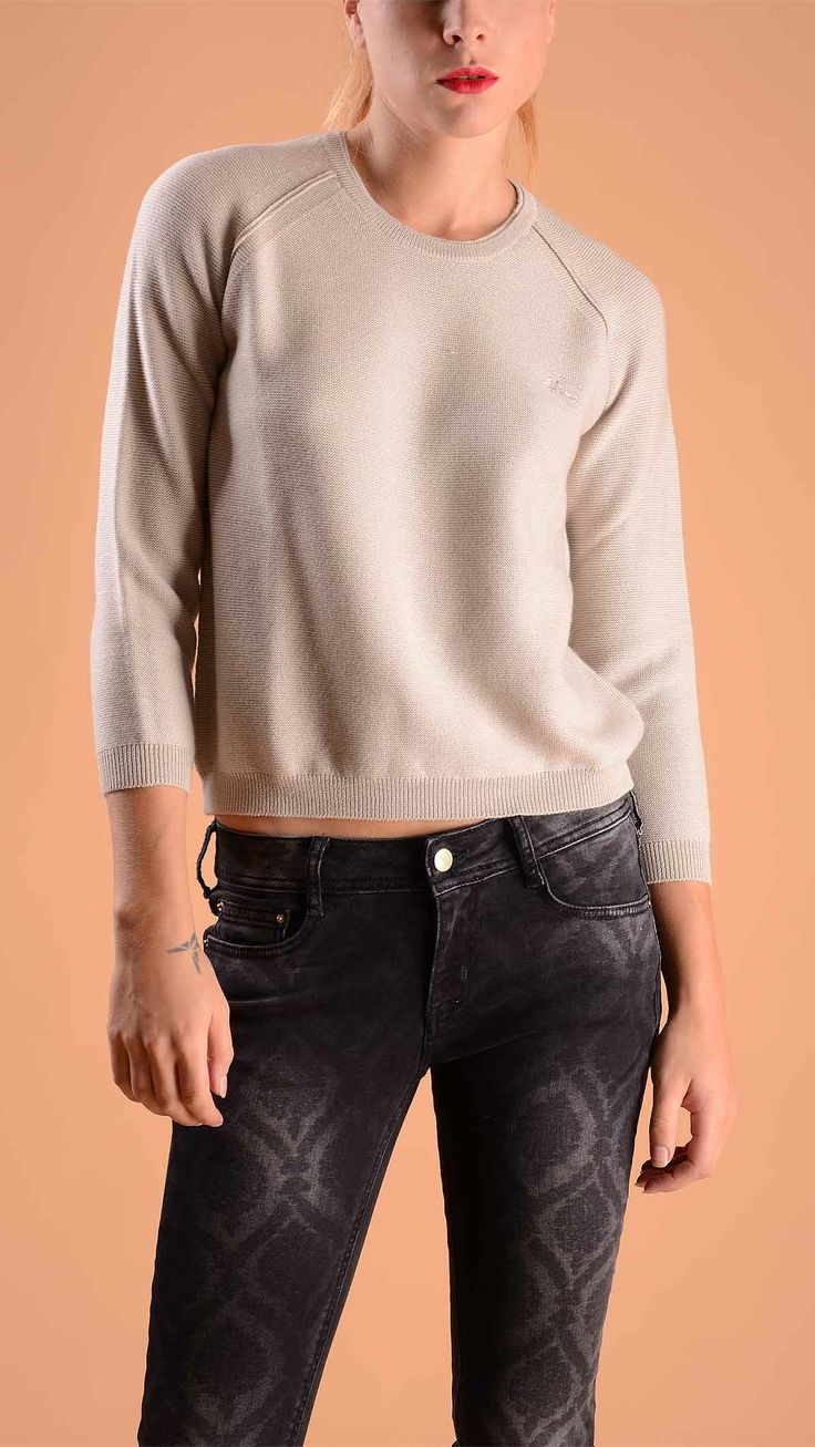 Burberry Three quarter sleeve crew neck jumper in beige, elasticated cuffs and bottom. 100% wool.