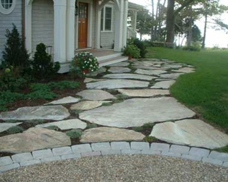 Front walkway - replacing the concrete sidewalk, would like to have a large fieldstone path.