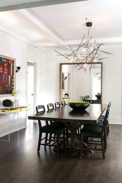 Note the color of the floor plus dark furniture (modern dining room by Shirley Meisels)