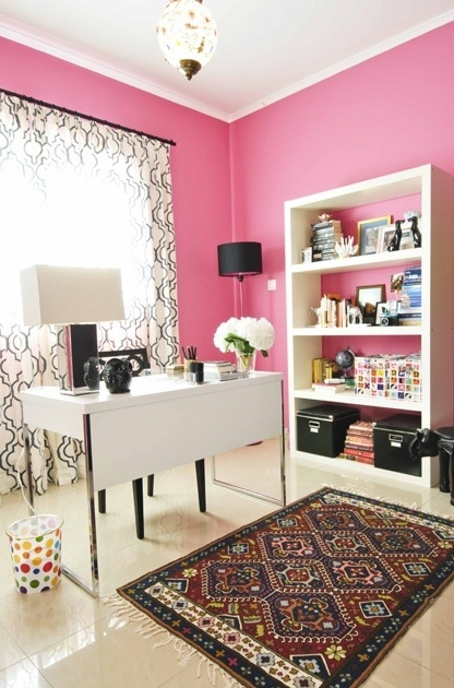 Pink office. Great space. The rug is unexpected and that is great.