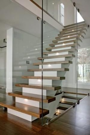 Floating wooden stairs on a white base staircase