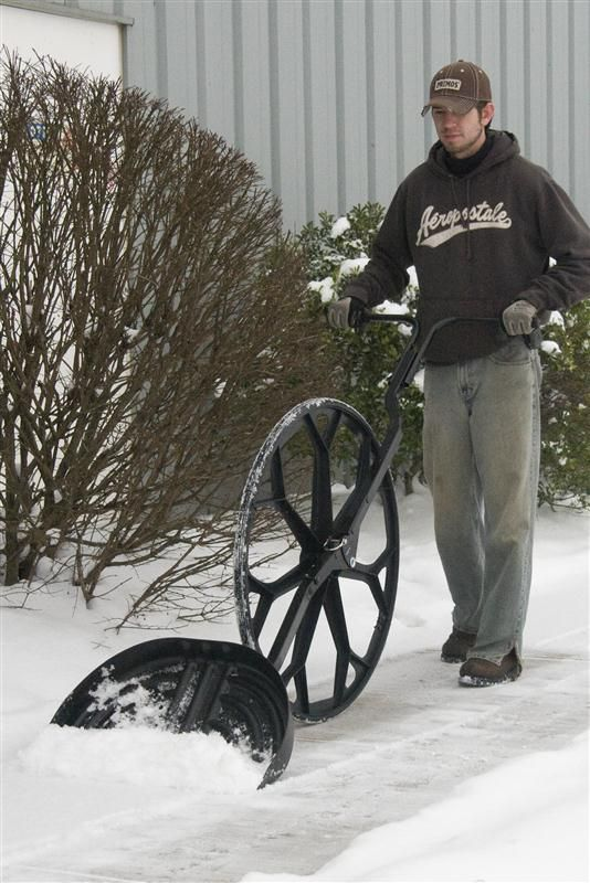 "End backbreaking, body-stressing shoveling snow Snow Wolf™ - the snow shovel on a wheel.$104.96 Shovel and throw snow with virtually no effort, twisting or lifting Roll the shovel along on the 33-1/2""OD wheel, then lift to throw snow anywhere you want it Designed to greatly reduce physical strain and the risk of injury Outperforms snow blowers, without the expense, fumes, maintenance or noise adjusts to body size and strength Easy to maneuver - works well in all snow conditions USA"