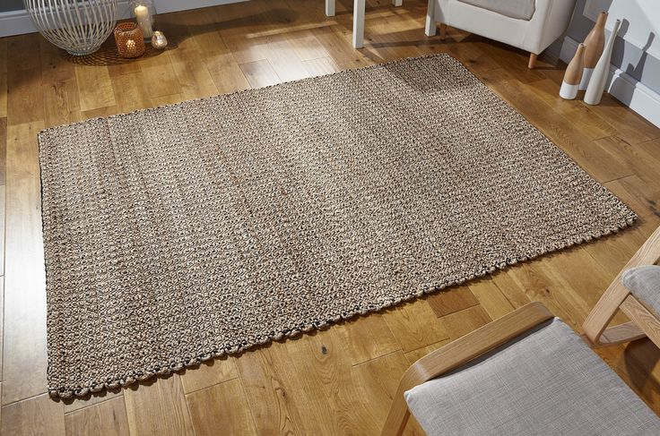 Hand woven in India using jute fibre, this beautiful and practical rug is a smart choice for high traffic areas. #naturalrugs #modernrugs #durablerugs #largerugs #brownrugs