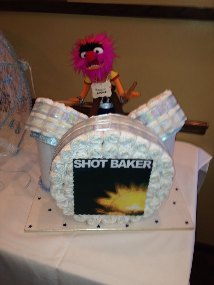 Diaper cake for baby shower. Daddy to be is a drummer :)