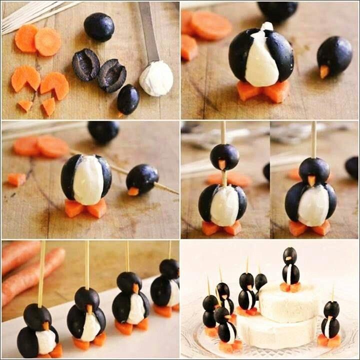 Simpele pinguinhapjes maken van olijven, wortel en platte kaas of mozzarella.
